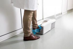 dentist near Severna Park stepping into shoe covering